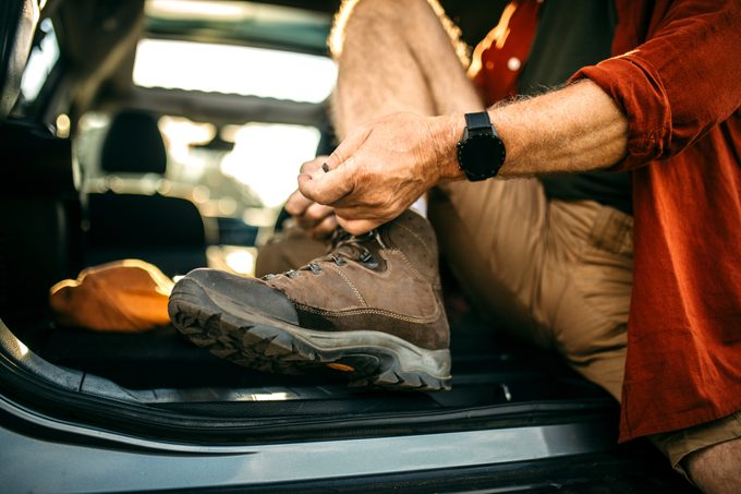 close up of man lacing up his hiking boots