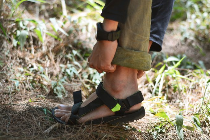 close up of woman wearing hiking sandals in nature