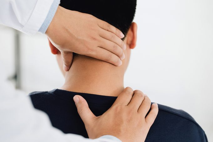 physiotherapist examining patient's neck for trigger points